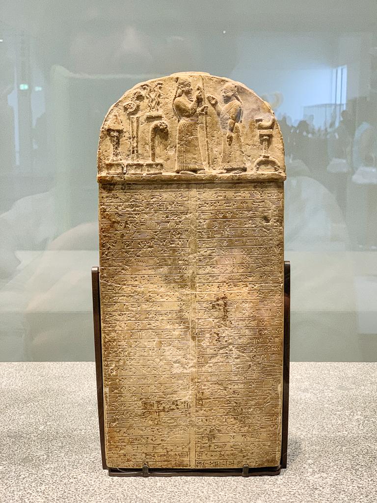 Stele in the name of Tutankhamun Egypt, Abydos c. 1327 BCE, H. 166, w. 82 cm; pink granite, LOUBRE ABU DHABI