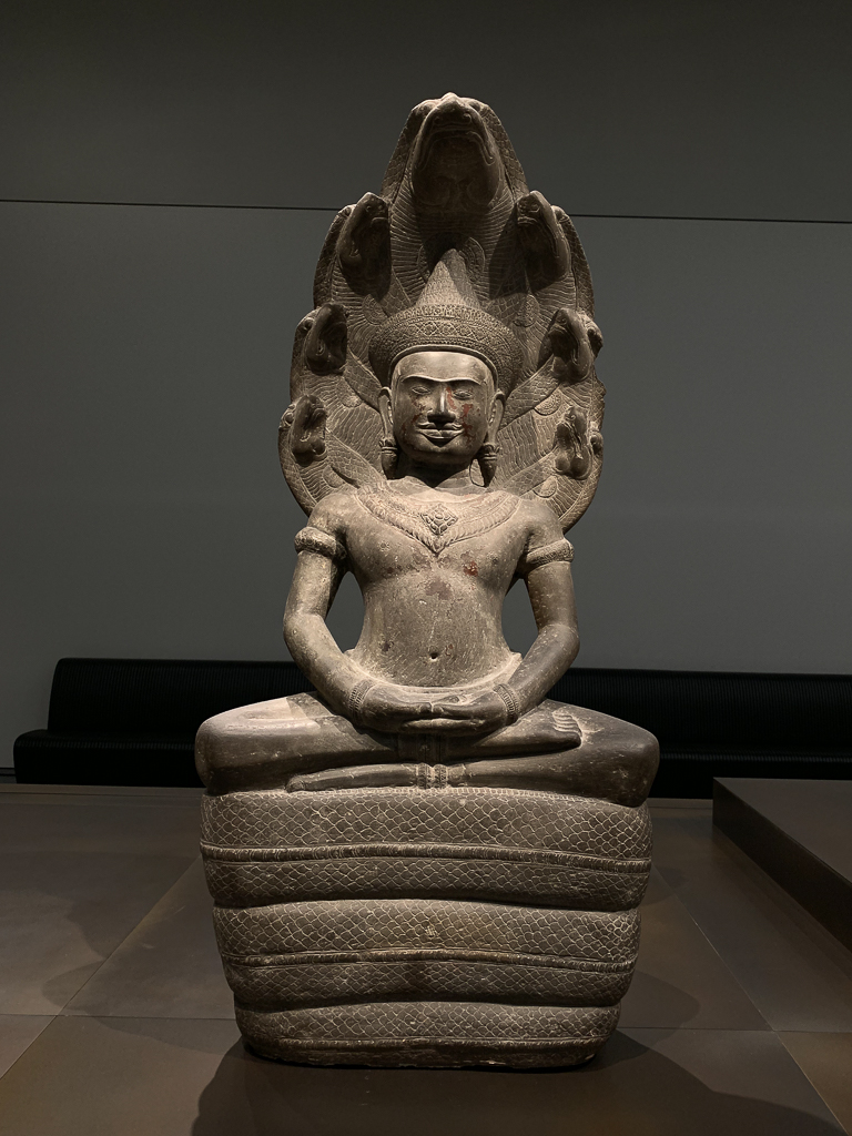 Meditating Buddha protected by the naga, Cambodia, 1100-1150, H. 111 cm; sandstone, traces of red lacquer