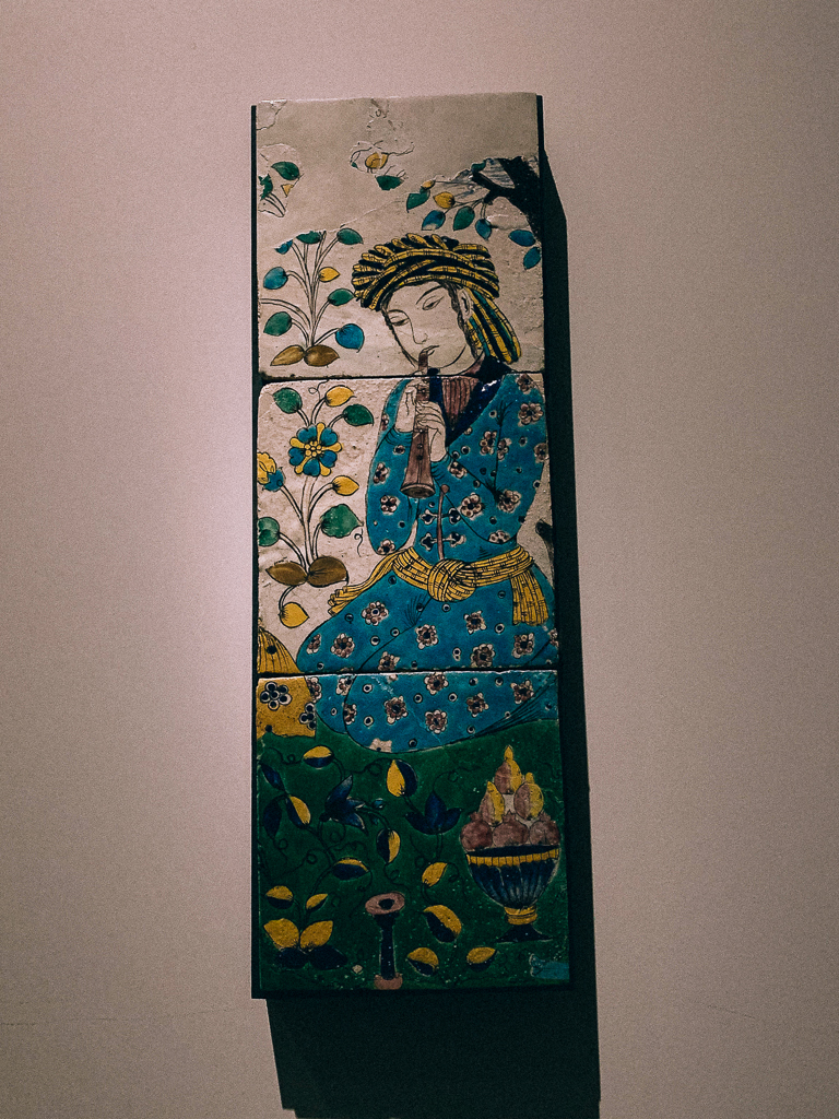 Panel with a flute player,  Iran, Isfahan or Qazvin 1680-1730 H. 72.7, W . 24cm;ceramic,  Musée du Louvre